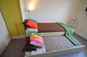 Un ou plusieurs lits dans un hébergement de l'établissement Montempô apparthôtel CDG Goussainville
