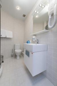 Ванная комната в Alex Hotel on Marshala Zhukova