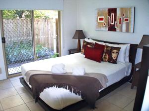 A bed or beds in a room at Clearwater Noosa Resort