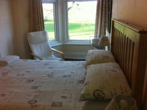 A bed or beds in a room at Chadwick Guest House