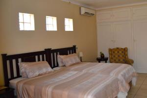 A bed or beds in a room at Augustavilla St.Pio's Guest House