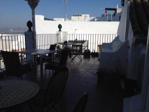 Un restaurante o sitio para comer en Apartamentos Casa la Costanilla