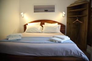 Un ou plusieurs lits dans un hébergement de l'établissement Hotel du Cap