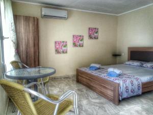 Ein Bett oder Betten in einem Zimmer der Unterkunft Stelios House