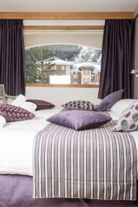 Un ou plusieurs lits dans un hébergement de l'établissement Hôtel de La Vanoise