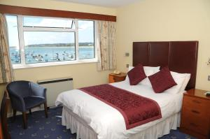 A bed or beds in a room at Dolphin Hotel
