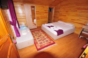 Кровать или кровати в номере Ikiz Pension Bungalow