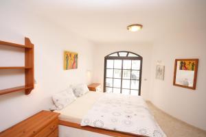 Ein Bett oder Betten in einem Zimmer der Unterkunft Casa Ronda