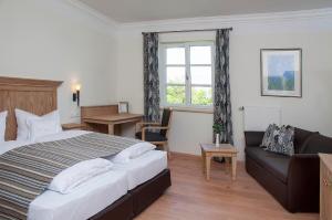 Ein Bett oder Betten in einem Zimmer der Unterkunft Hotel Zum Schlössle