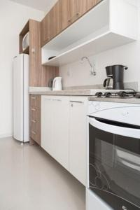A kitchen or kitchenette at Apartamento Atalaia
