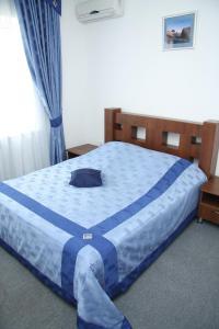 Кровать или кровати в номере Отель Корона