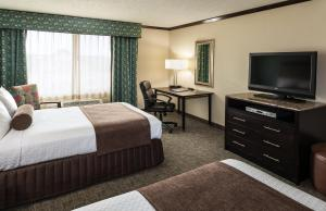 A television and/or entertainment center at Crowne Plaza Anchorage-Midtown, an IHG hotel