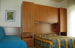 Postel nebo postele na pokoji v ubytování Pensione Villa Joli