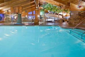The swimming pool at or near AmericInn by Wyndham Chippewa Falls