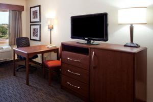A television and/or entertainment center at AmericInn by Wyndham Chippewa Falls