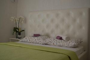 A bed or beds in a room at Villa Lanca