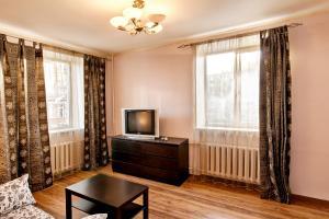 Телевизор и/или развлекательный центр в City Inn Апартаменты Белорусская