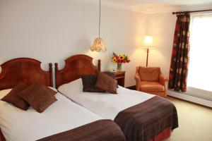 A bed or beds in a room at Knipoch House Hotel