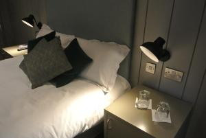 A bed or beds in a room at The Crown Pub, Dining & Rooms