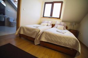 Łóżko lub łóżka w pokoju w obiekcie Ośrodek Wypoczynkowo Sportowy Pod Żurawiem