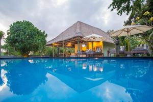 The swimming pool at or near Komodo Garden