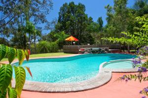 The swimming pool at or near Noosa North Shore Retreat