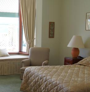 A bed or beds in a room at The Lodge Country House