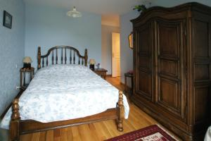 A bed or beds in a room at La Grande Malardiere