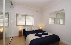 A bed or beds in a room at Beachside Bliss - A Bondi Beach Holiday Home