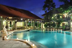 The swimming pool at or near Adhi Jaya Hotel
