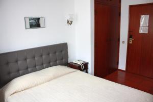 Uma cama ou camas num quarto em Hotel Dona Leonor