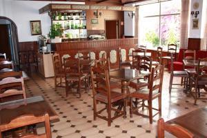 The lounge or bar area at Hotel Dona Leonor