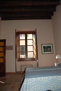 Letto o letti in una camera di B&B Via Roma 9