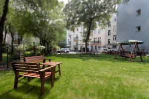 A garden outside Abella Suites & Apartments by Artery Hotels