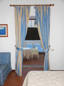 Letto o letti in una camera di Hotel Villa Meligunis