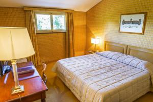 A bed or beds in a room at Hotel Villa La Principessa