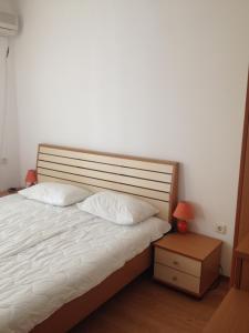 Кровать или кровати в номере Levante Apartcomplex