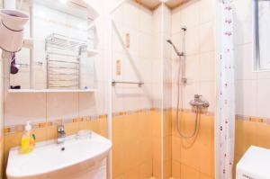 Ванная комната в Апартаменты на Джигитской