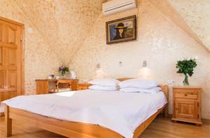 Кровать или кровати в номере Апартаменты на Джигитской