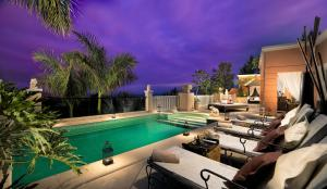The swimming pool at or near Royal Garden Villas & Spa, Luxury Hotel