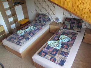 Postel nebo postele na pokoji v ubytování Pension U Vlášků