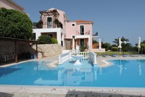 The swimming pool at or near Aristomenis Studios