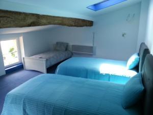 Un ou plusieurs lits dans un hébergement de l'établissement Le Gîte du Port