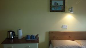 A bed or beds in a room at The Perrin Inn
