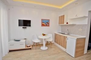 Кухня или мини-кухня в Gospostina Apartment