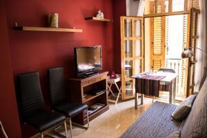 Una televisión o centro de entretenimiento en Apartamento Valencia Center