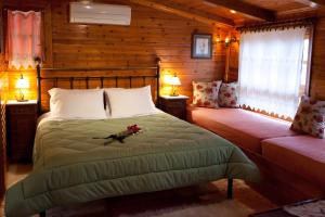 A bed or beds in a room at Pension Eleni