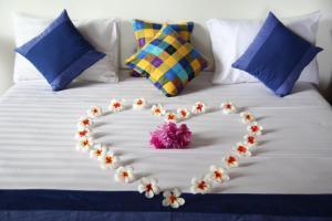 Ein Bett oder Betten in einem Zimmer der Unterkunft Bali Marina Villa's