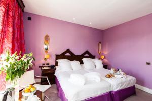 A bed or beds in a room at RL Ciudad de Úbeda