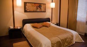 Кровать или кровати в номере Гостиница Евразия